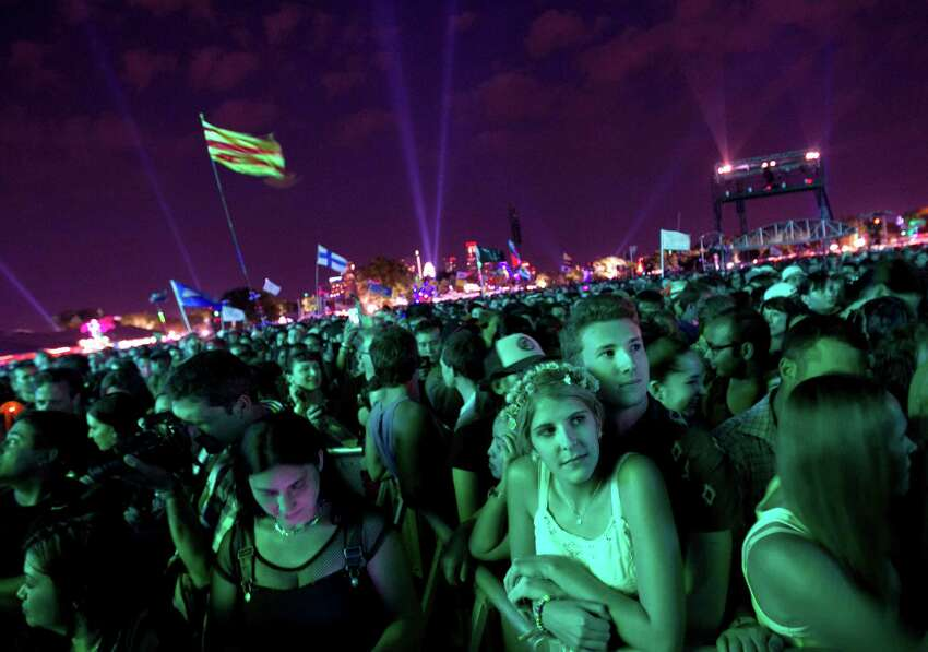 Kendall Becker, 17, and Kenneth Ruddy, 17, wait for The Cure at the Austin City Limits Music Festival, Saturday, Oct. 5, 2013 at Zilker Park in Austin, Texas.