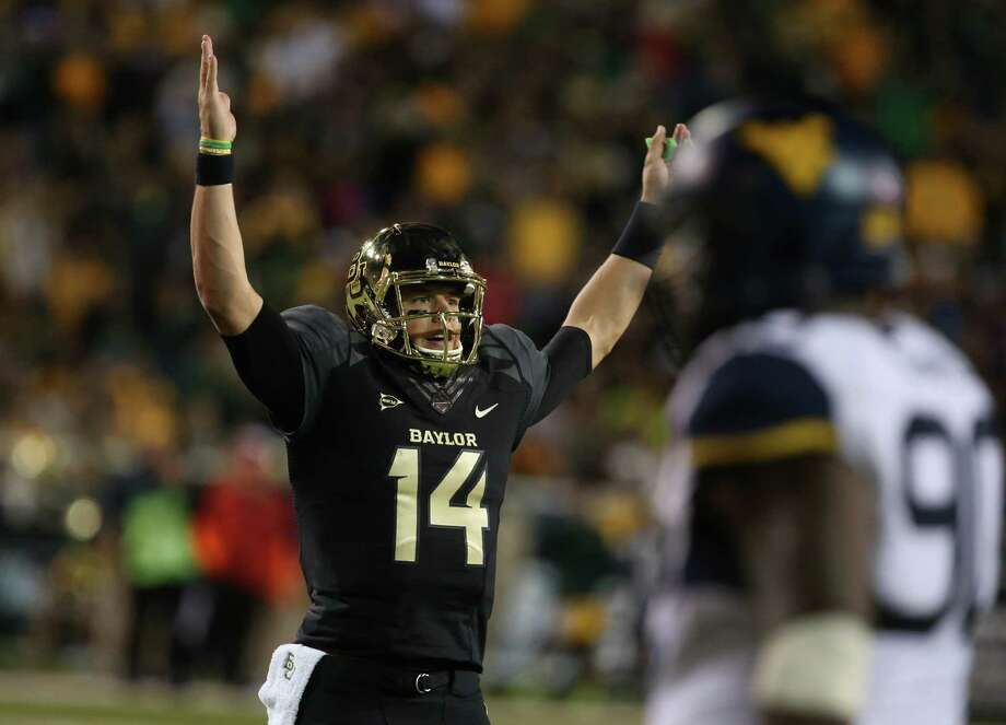 Baylor quarterback Bryce Petty (14), holds up his hands after a touchdown against West Virginia during the first half of an NCAA college football game on Saturday, Oct.  5, 2013, in Waco, Texas.  (AP Photo/Rod Aydelotte) Photo: Rod Aydelotte, Associated Press / FR 36102AP