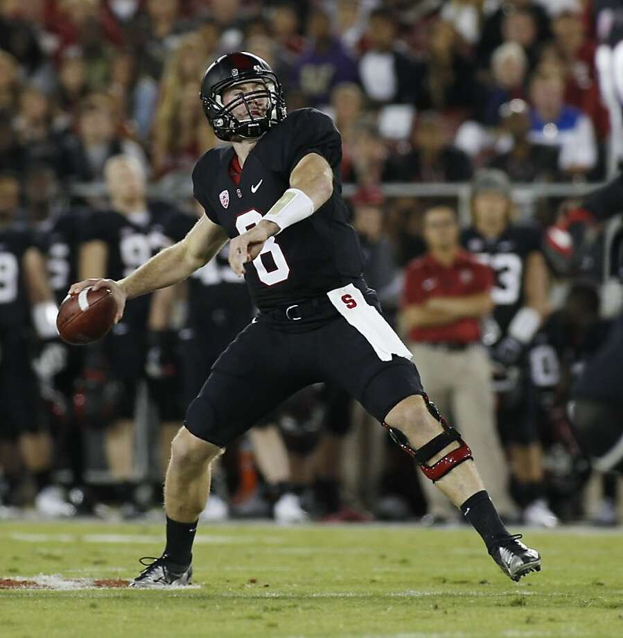 Kevin Hogan and the Cardinal wore black for their Pac-12 matchup against Washington and produced a positive result for their red-clad fans. Photo: George Nikitin, Associated Press