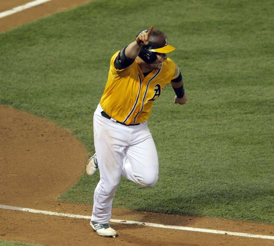 Stephen Vogt reacts after he hit the game-winning hit to score Yoenis Cespedes in the bottom of the ninth inning. The Oakland Athletics played the Detroit Tigers in Game 2 of the American League Division Series at O.co Coliseum in Oakland, Calif., on Saturday, October 5, 2013. Photo: The Chronicle