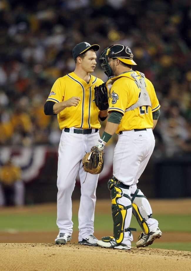 Stephen Vogt comes to the mound to talk with Sonny Gray. The Oakland Athletics played the Detroit Tigers in Game 2 of the American League Division Series at O.co Coliseum in Oakland, Calif., on Saturday, October 5, 2013. Photo: Michael Macor, The Chronicle