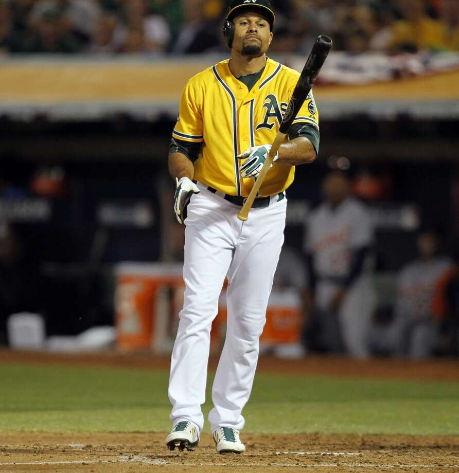 Coco Crisp tosses his bat after striking out in the fourth inning. The Oakland Athletics played the Detroit Tigers in Game 2 of the American League Division Series at O.co Coliseum in Oakland, Calif., on Saturday, October 5, 2013. Photo: Michael Macor, The Chronicle