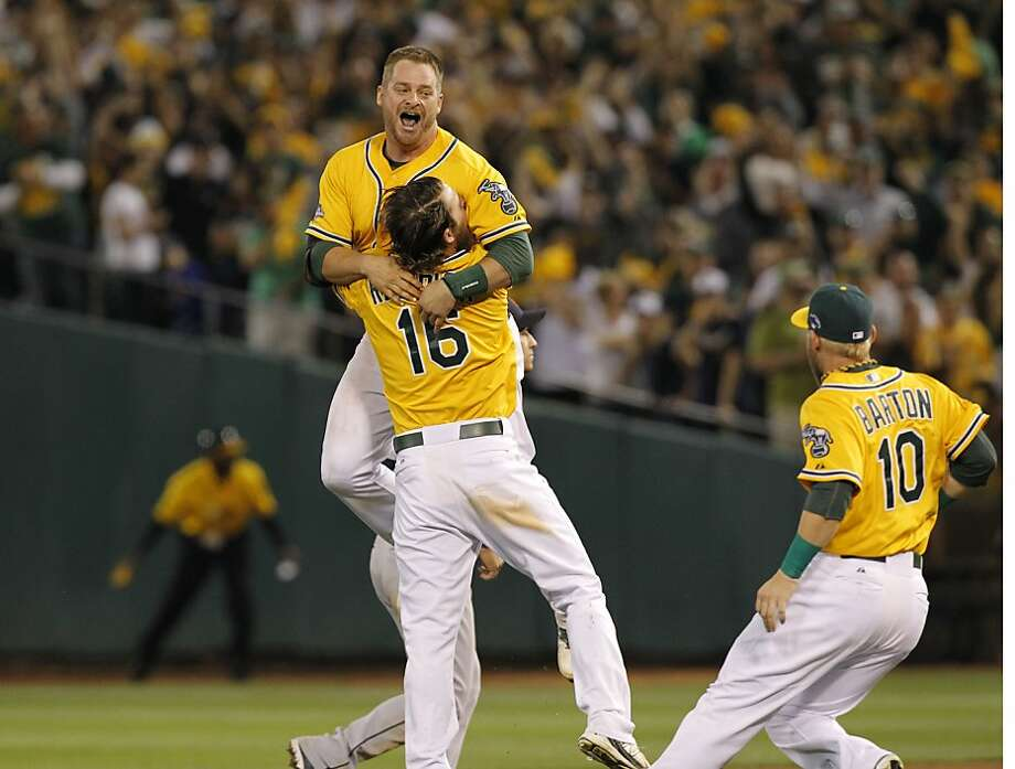 A's rookie catcher Stephen Vogt jumps into the arms of Josh Reddick (16) after Vogt's walk-off single. Photo: Michael Macor, The Chronicle