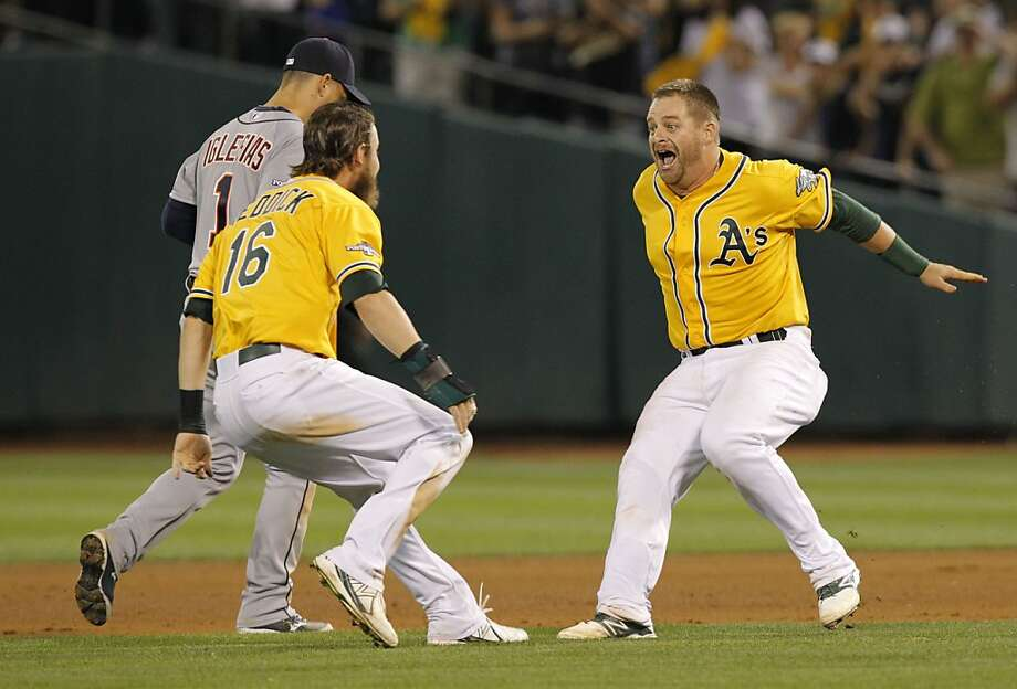 Stephen Vogt gets ready to leap into Josh Reddick's arms after knocking in the only run Saturday. Earlier, Vogt threw out a runner and had a 10-pitch at-bat against Justin Verlander. Photo: Michael Macor, The Chronicle