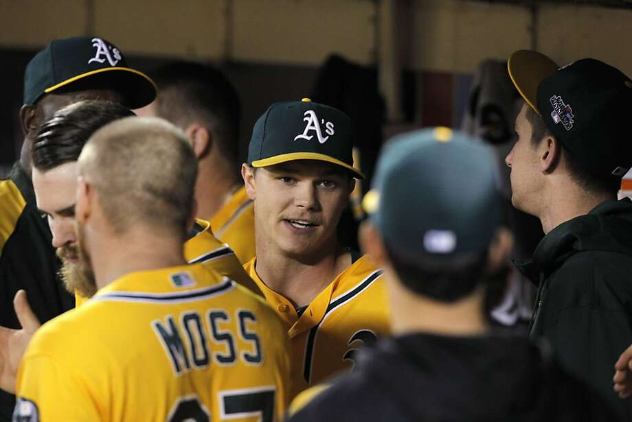 "Sonny Gray is greeted in the dugout after the seventh. ""I don't think any of us were worried about him,"" GM Billy Beane said. Photo: Michael Macor, The Chronicle"