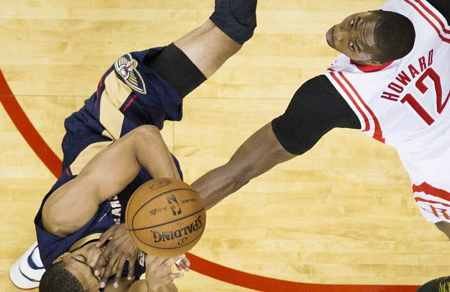 Oct. 5: Pelicans 116, Rockets 115  Pelicans power forward Anthony Davis gets a hand in the face from Rockets center Dwight Howard. Photo: Smiley N. Pool, Houston Chronicle