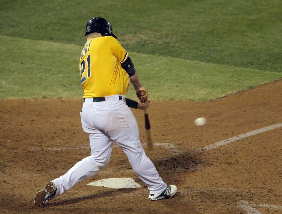 Stephen Vogt hits the game-winning single to score Yoenis Cespedes in the bottom of the ninth inning. The Oakland Athletics played the Detroit Tigers in Game 2 of the American League Division Series at O.co Coliseum in Oakland, Calif., on Saturday, October 5, 2013. Photo: The Chronicle
