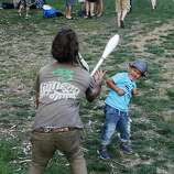 Ryan Kohlsdorf (left) juggles with Juan Simon Bolivar at the Hardly Strictly Bluegrass Festival in Golden Gate Park, in San Francisco, Ca, on Saturday, Oct. 5, 2013.