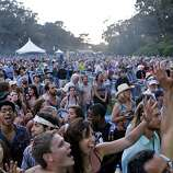 People at the front of the crowd cheer and dance for The Flatlanders at the Hardly Strictly Bluegrass Festival in Golden Gate Park, in San Francisco, Ca, on Saturday, Oct. 5, 2013.