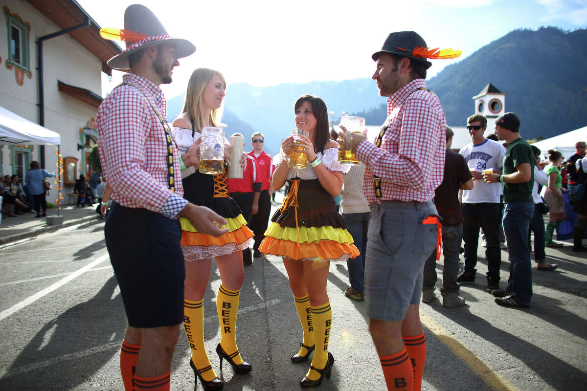 Tony Eggink, Erin Morrissey, Katy Clark and Hunter Eggink enjoy their brews during the first weekend of the annual Leavenworth Oktoberfest celebration on Saturday, October 5, 2013. The annual festival draws thousands to the small Bavarian-themed town. Historically, Oktoberfest started as the 1810 wedding celebration of Prince Ludwig l and Princess Therese from Saxony-Hildburghausen near Munich, Germany. The celebration became an annual tradition. The Oktoberfest celebration in Leavenworth continues October 11-12 and 18-19.