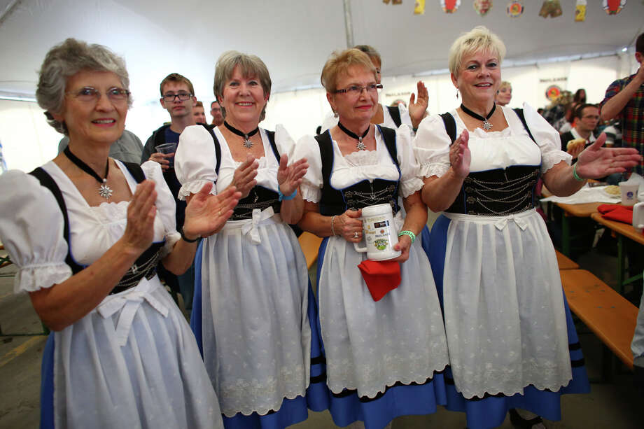 Members of Edelweiss Tanz Gruppe clap as members of their group dance. Photo: JOSHUA TRUJILLO, SEATTLEPI.COM / SEATTLEPI.COM