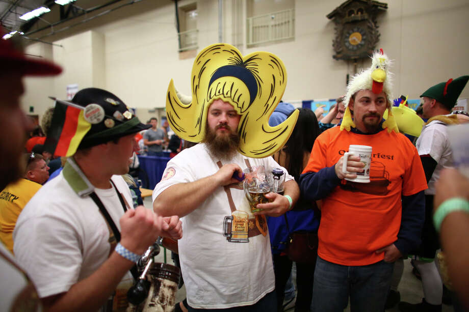 Participants, including Alex Sellmann, with big hair, enjoy their beers. Photo: JOSHUA TRUJILLO, SEATTLEPI.COM / SEATTLEPI.COM