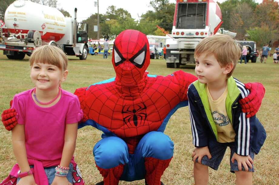 Jessica Howe, 7, left, and Andrew Howe, 3, right, of Norwalk, met one of their favorite superheroes Saturday -- Spiderman -- at Kidzfest Touch-A-Truck. Photo: Jarret Liotta / Norwalk Citizen contributed