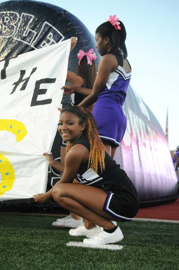 Humble High School varsity cheerleader Nekyia Francis, 15, waits for the Wildcats to take the field before their game versus Barbers Hill at Turner Stadium. Photo: Jerry Baker, For The Chronicle