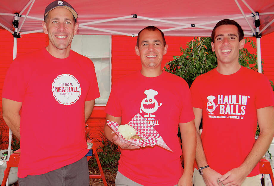 Alan and Mike DiStassio, with Justin Britton, of the Local Meatball specialty food cart, at the PopShop Market on Saturday. Photo: Mike Lauterborn / Fairfield Citizen contributed