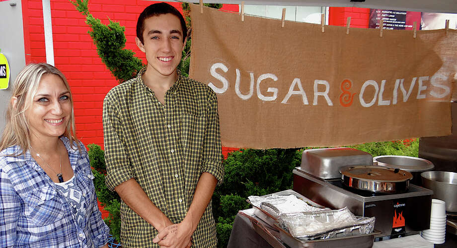 Nancy Mola and Noel Berry of Sugar & Olives of Norwalk at the fall PopShop Market downtown Saturday. Photo: Mike Lauterborn / Fairfield Citizen contributed