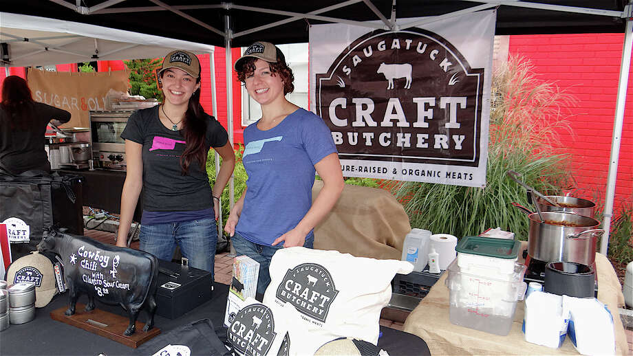 Taylor Conti and Sam Garwin of Saugatuck Craft Butchery at the PopShop Market held Saturday on grounds of of the Fairfield Theatre Company. Photo: Mike Lauterborn / Fairfield Citizen contributed