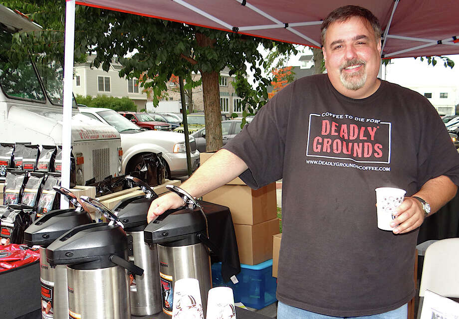 Tom Lialios, owner of Deadly Grounds Coffee, at Saturday's PopShop Market downtown. Photo: Mike Lauterborn / Fairfield Citizen contributed