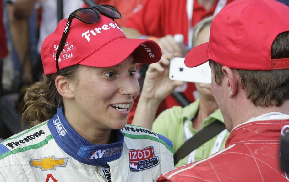 Simona De Silvestro, left, who placed second, talks with winner Scott Dixon, right, after Race 1 on Saturday. Photo: Melissa Phillip, Houston Chronicle