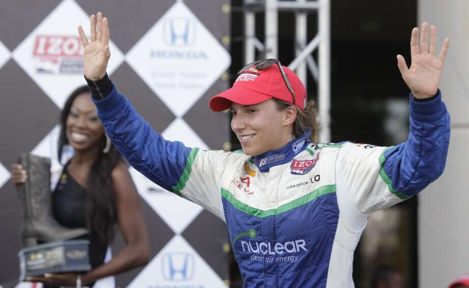 Simona De Silvestro takes the stage for the awards ceremony after placing second in Race 1. Photo: Melissa Phillip, Houston Chronicle