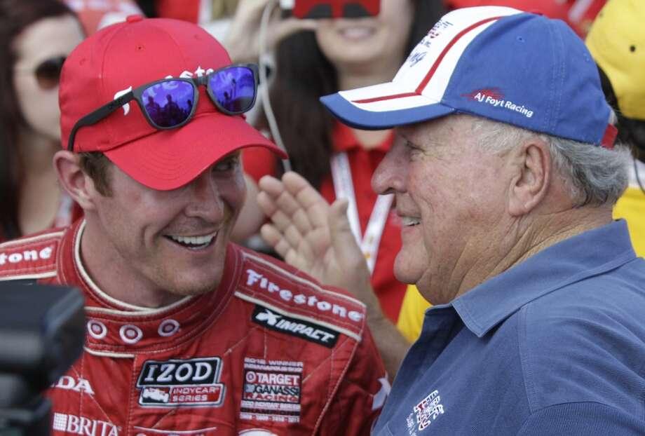 Scott Dixon, left, talks with A.J. Foyt, right, after Dixon won Race 1. Photo: Melissa Phillip, Houston Chronicle