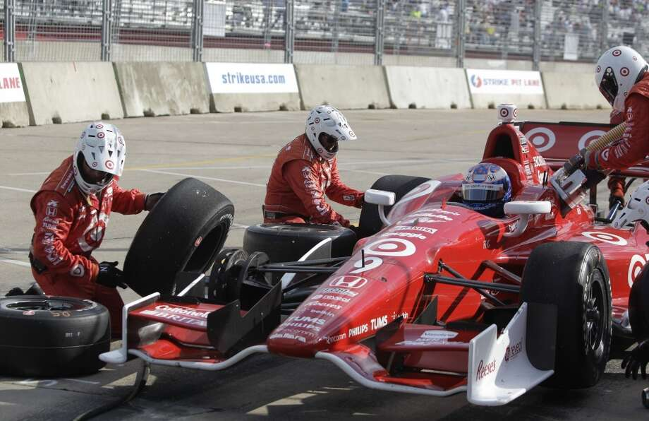 Scott Dixon makes a pit stop during Race 1 of the Shell and Pennzoil Grand Prix of Houston at Reliant Park on Saturday. Photo: Melissa Phillip, Houston Chronicle