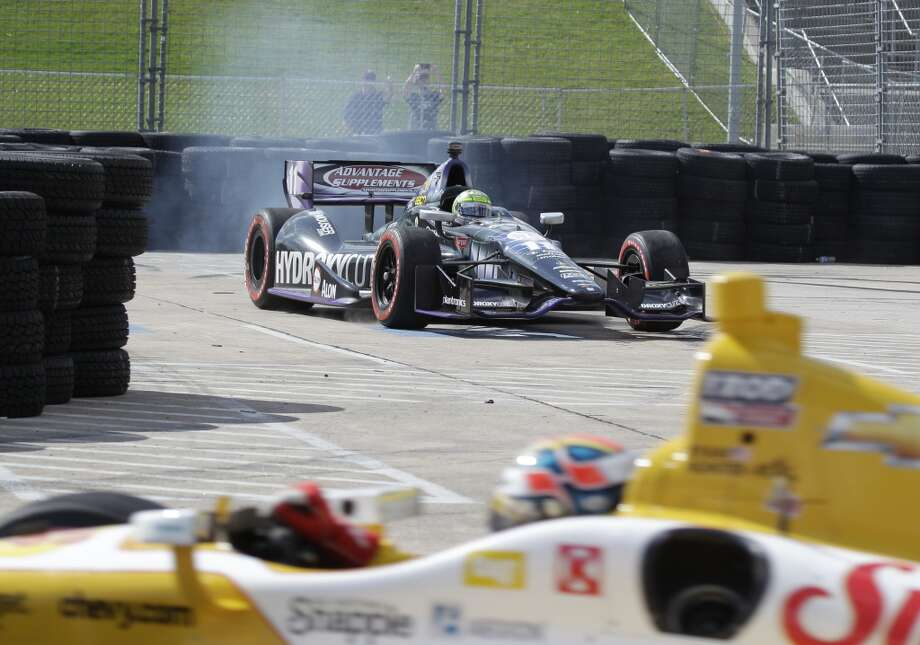 Tony Kanaan works to get out of runoff area at Turn 6 during the Grand Prix of Houston IndyCar Race 1 at Reliant Park. Photo: Melissa Phillip, Houston Chronicle