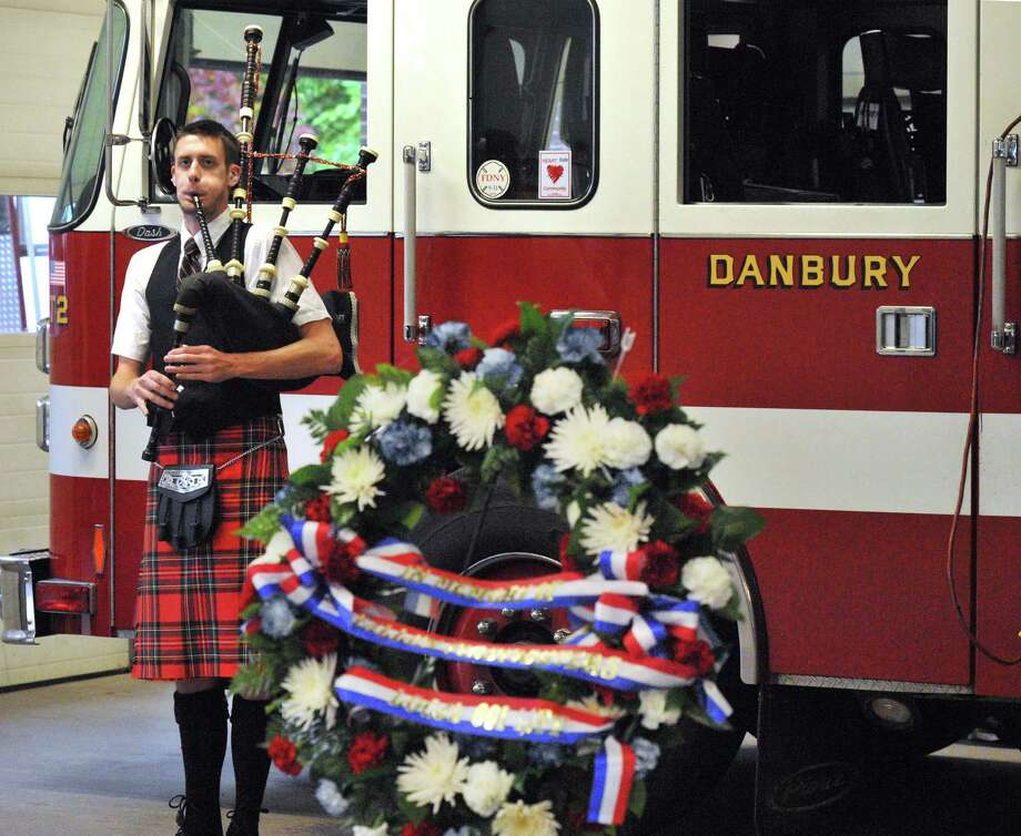 The Danbury Fire Department awards ceremony is held in the New Street firehouse, in Danbury, Conn. Sunday, Oct. 6, 2013 Photo: Michael Duffy / The News-Times