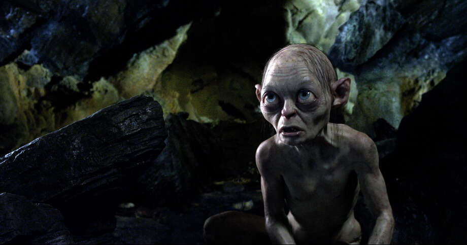 "FILE - This publicity file photo provided by Warner Bros., shows the character Gollum, voiced by Andy Serkis, in a scene from the fantasy adventure ""The Hobbit: An Unexpected Journey."" Making ""The Hobbit"" movie trilogy has cost more than half a billion dollars so far, double the amount spent on ""The Lord of the Rings"" trilogy. That figure includes the major shoots with actors, although there will likely be additional post-production costs as the next two movies are completed. Photo: AP"
