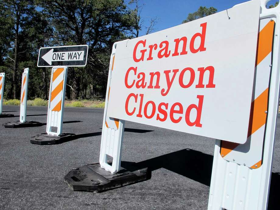 A sign at the south entrance to Grand Canyon National Park, Ariz., indicates the park is closed on Thursday, Oct. 3, 2013.  More than 400 national parks are closed as Congress remains deadlocked over federal government funding. Photo: AP