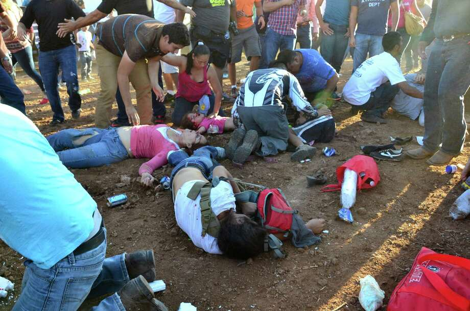 Injured people are treated after an out of control monster truck plowed through a crowd of spectators at a Mexican air show in the city of Chihuahua, Mexico, Saturday Oct. 5, 2013. According to authorities, at least 8 people were killed and 80 were injured. Photo: AP