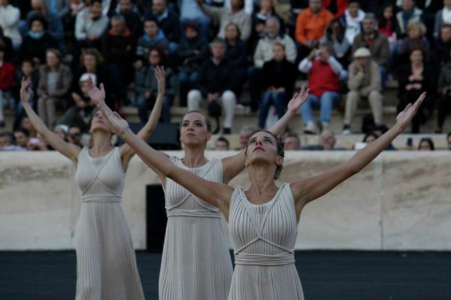 Actresses playing the role of ancient Greek priestesses perform a ritual dance during a handover ceremony of the Olympic Flame in Athens' Panathinaiko Stadium, on Saturday, Oct. 5, 2013. The Olympic flame has been handed to organizers of the Sochi Winter Olympics in a ceremony at the site of the first modern summer games. After a seven-day run through Greece, the flame will cover 40,000 miles on Russian soil. The record-setting relay will start on Monday in Moscow and finish in Sochi on Feb. 7, the opening day of the games. Photo: AP