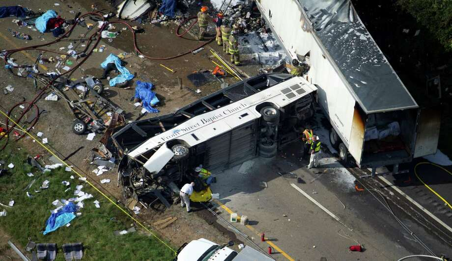 In this aerial photo, emergency workers respond to a crash involving a passenger bus, a tractor-trailer and an SUV near Dandridge, Tenn., on Wednesday, Oct. 2, 2013. Authorities said the bus, carrying members of a North Carolina church group, veered across the highway median and crashed into the other vehicles in a fiery wreck that killed several people. Photo: AP