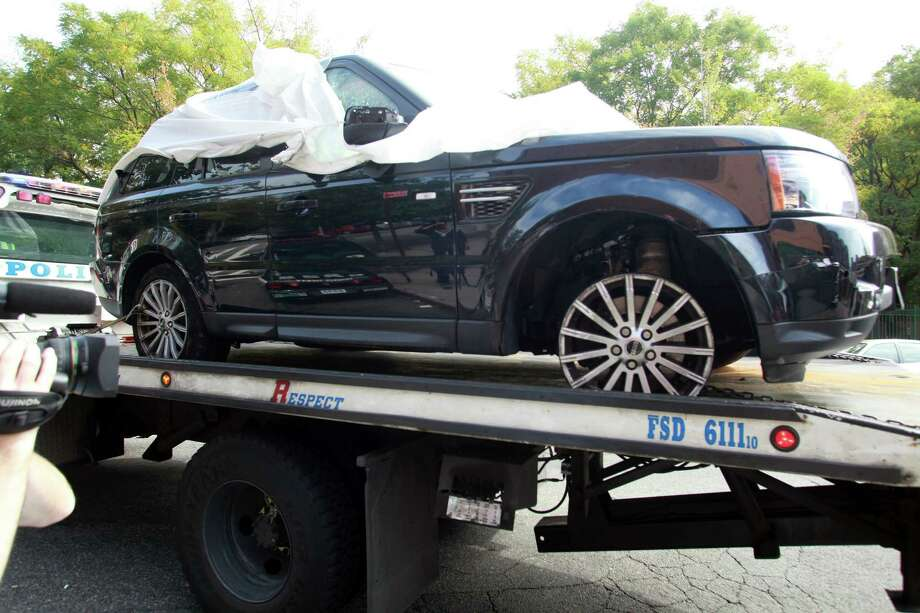 The Range Rover involved in the bikers attack is being moved from the police precinct for further police investigation Saturday, Oct. 5, 2013 in New York.  Last weekend, dozens of bikers stopped the Range Rover SUV on a highway, attacked the vehicle, then chased the driver and pulled him from the car after he plowed over a motorcyclist while trying to escape, police said.  The driver, Alexian Lien, needed stitches after being pummeled by the bikers. The motorcyclist who was crushed by the SUV, Edwin Mieses Jr., of Lawrence, Massachusetts, suffered a broken spine and two broken legs and may never walk again, his family said. Robert Sims, 35, of Brooklyn, was arrested on charges of gang assault and weapons possession. Police said he took part in the attack on Lien Photo: AP