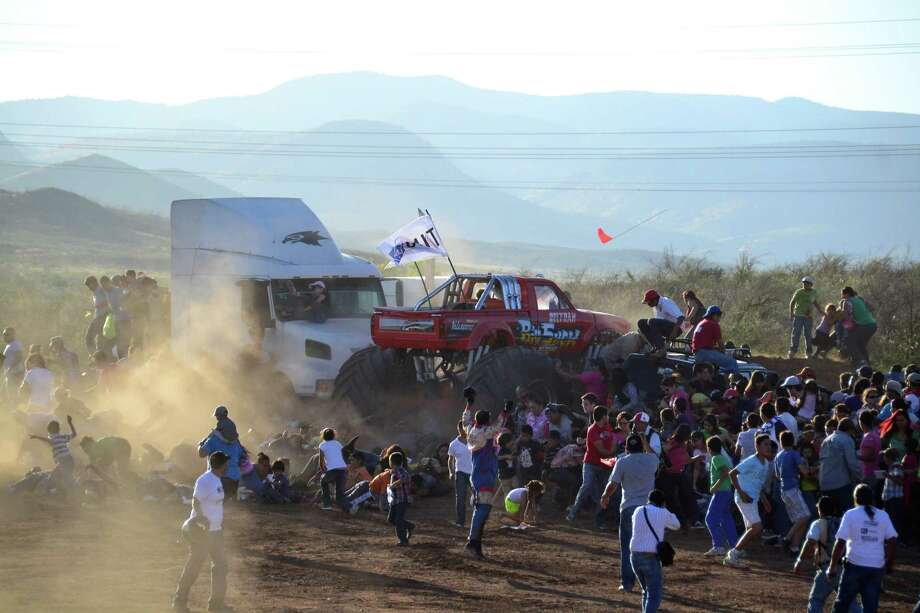 People run as an out of control monster truck plows through a crowd of spectators at a Mexican air show in the city of Chihuahua, Mexico, Saturday Oct. 5, 2013. According to authorities, at least 8 people were killed and 80 were injured. Photo: AP