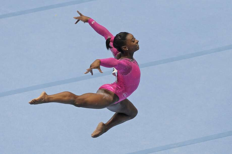 Gold medallist Simone Biles of the U.S. competes to win the floor exercise during the apparatus final on Sunday. Photo: Yves Logghe, Associated Press