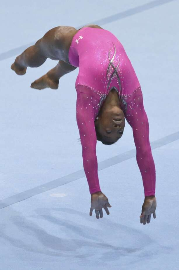 Gold medallist Simone Biles competes to win the floor exercise during the apparatus final on Sunday. Photo: Virginia Mayo, Associated Press