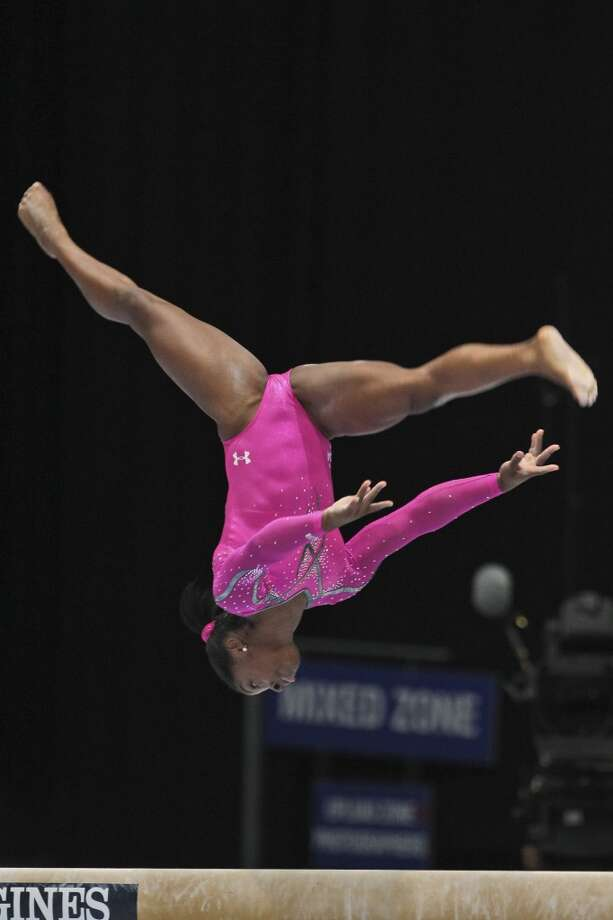 Simone Biles competes on the balance beam during the apparatus final on Sunday. Photo: Yves Logghe, Associated Press