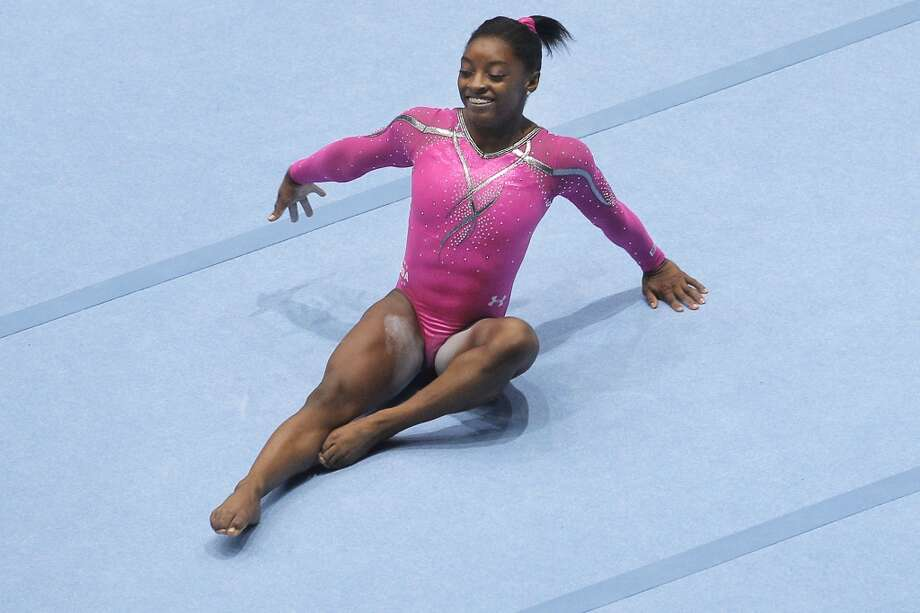Gold medallist Simone Biles competes to win the floor exercise during the apparatus final on Sunday. Photo: Yves Logghe, Associated Press