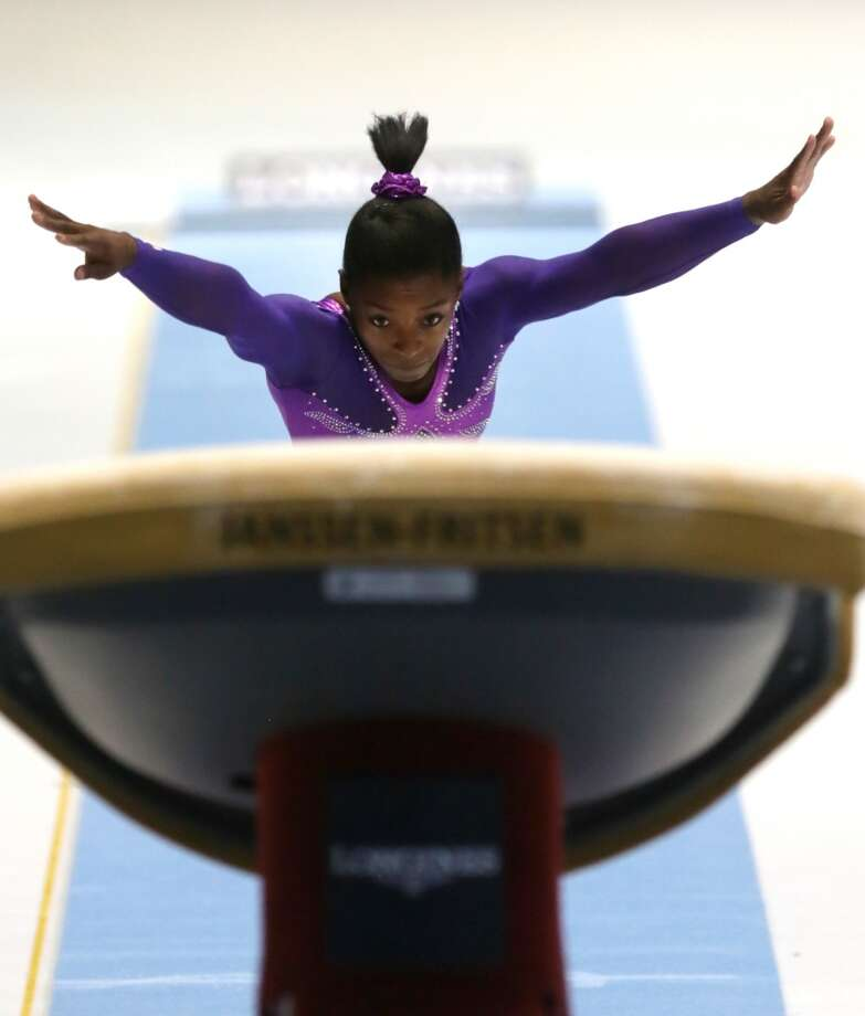 Simone Biles competes in the vault during the apparatus final on Saturday. Photo: Virginia Mayo, Associated Press