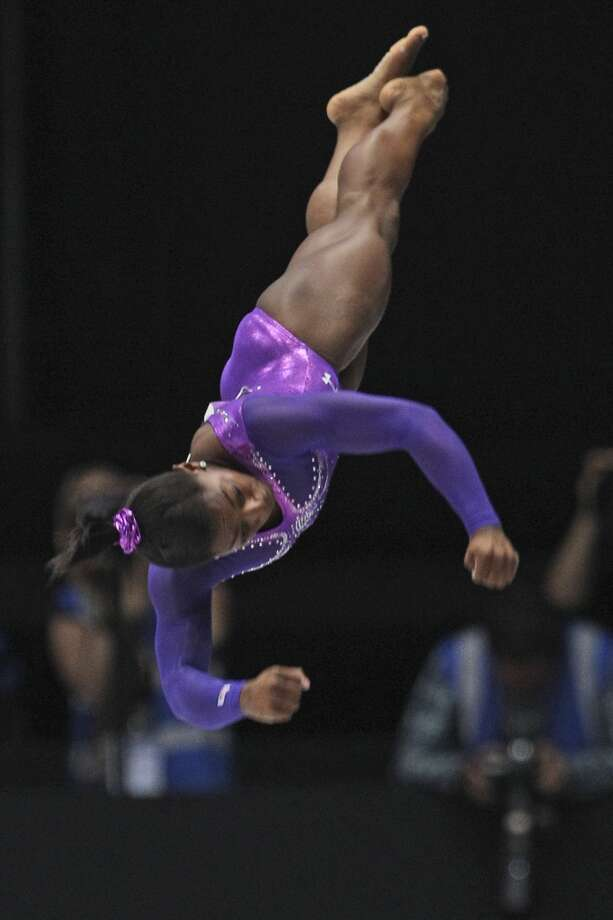 Simone Biles performs on the vault during the apparatus final on Saturday. Photo: Yves Logghe, Associated Press