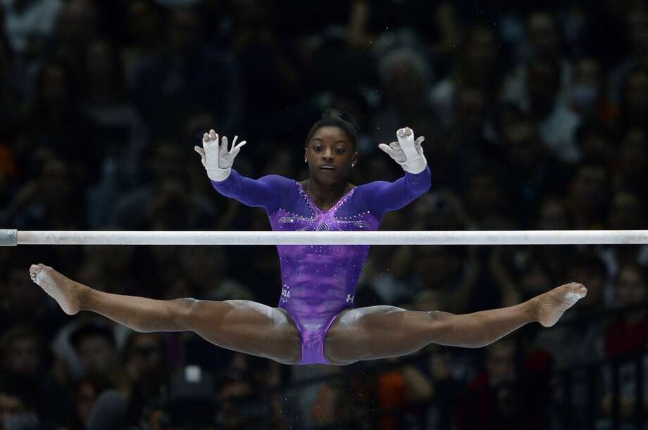 Simone Biles competes in the uneven bars event of the apparatus final on Saturday. Photo: MARTIN BUREAUMARTIN BUREAU/, Getty Images