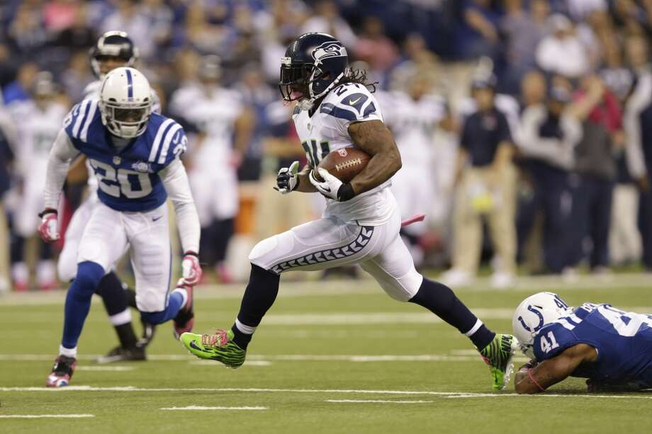 Seattle Seahawks running back Marshawn Lynch runs against the Indianapolis Colts during the first half of an NFL football game in Indianapolis, Sunday, Oct. 6, 2013. (AP Photo/Michael Conroy) Photo: Michael Conroy, AP
