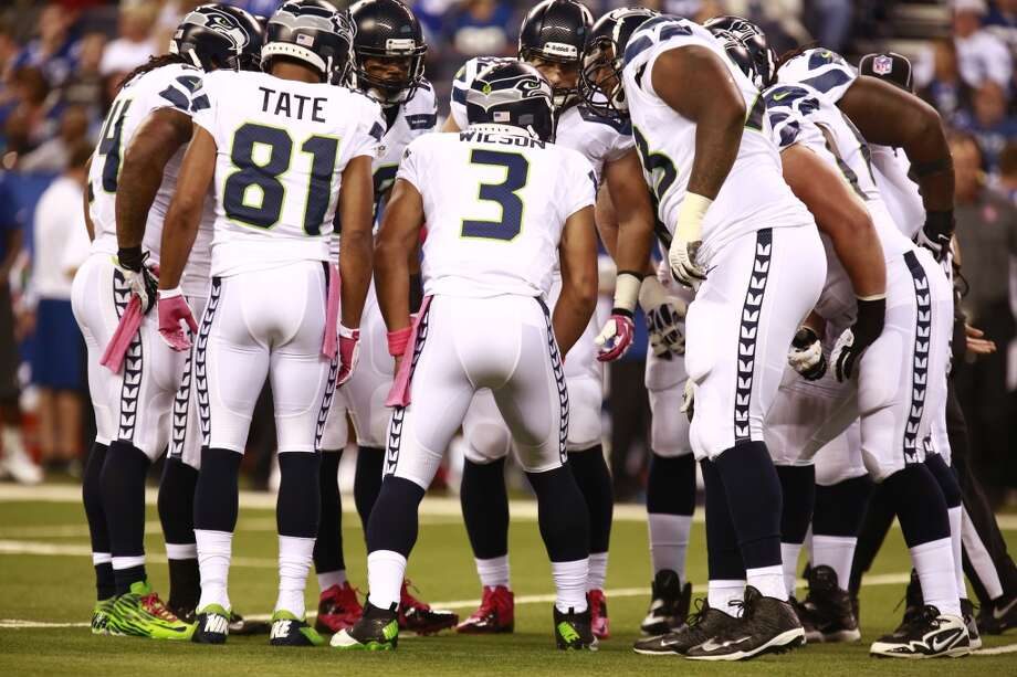 The Seattle Seahawks huddle against the Indianapolis Colts during the first half of an NFL football game in Indianapolis, Sunday, Oct. 6, 2013. (AP Photo/Brent R. Smith) Photo: Brent R. Smith, AP