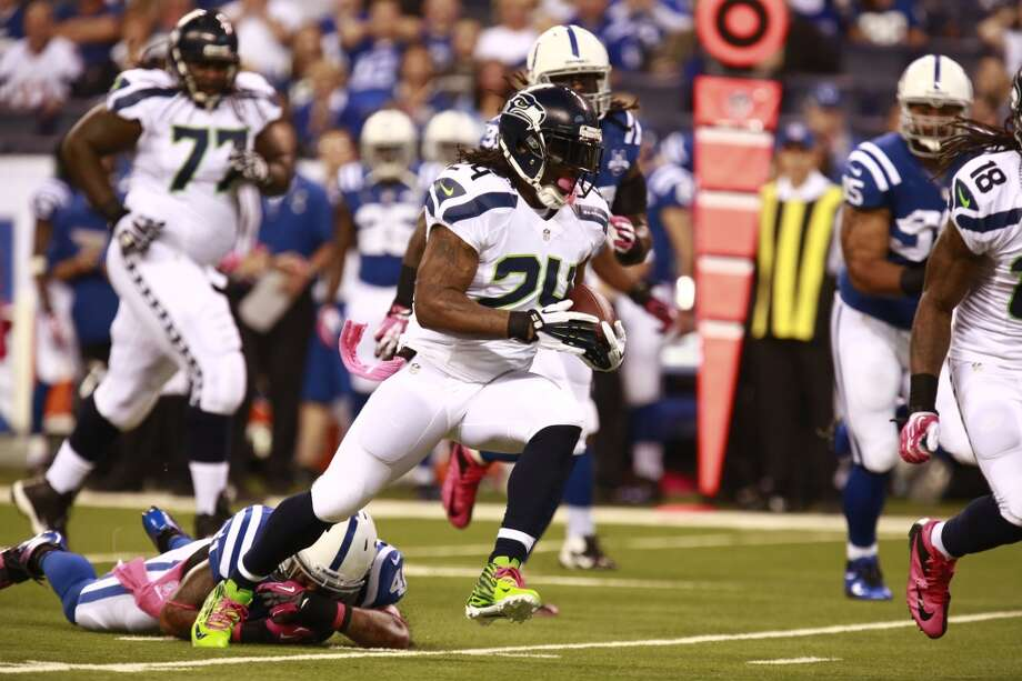 Seattle Seahawks running back Marshawn Lynch runs against the Indianapolis Colts during the first half of an NFL football game in Indianapolis, Sunday, Oct. 6, 2013. (AP Photo/Brent R. Smith) Photo: Brent R. Smith, AP