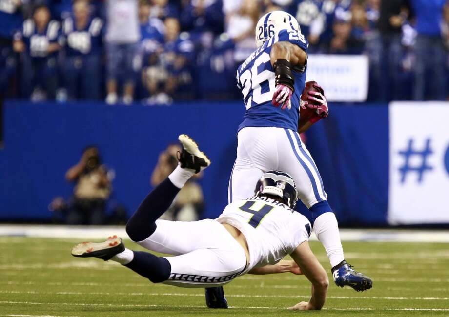 Indianapolis Colts free safety Delano Howell, top, avoids the tackle of Seattle Seahawks on his way to a touchdown on a blocked punt during the first half of an NFL football game in Indianapolis, Sunday, Oct. 6, 2013. (AP Photo/Brent R. Smith) Photo: Brent R. Smith, AP