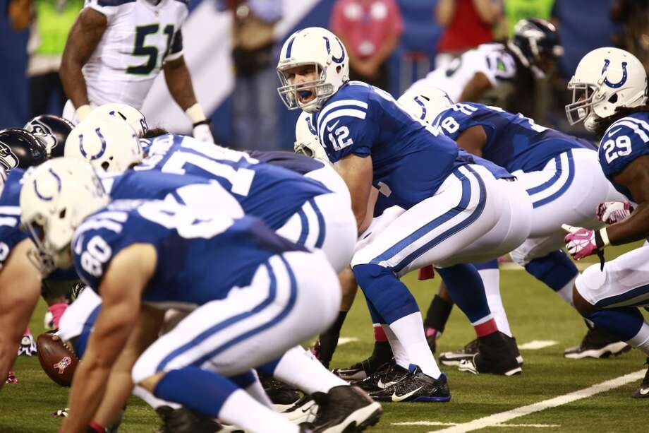 Indianapolis Colts quarterback Andrew Luck dlls a play at the line of scrimmage against the Seattle Seahawks during the first half of an NFL football game in Indianapolis, Sunday, Oct. 6, 2013. (AP Photo/Brent R. Smith) Photo: Brent R. Smith, AP