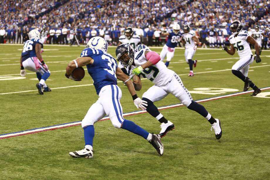 Seattle Seahawks free safety Earl Thomas, right, tackles Indianapolis Colts running back Donald Brown during the first half of an NFL football game in Indianapolis, Sunday, Oct. 6, 2013. (AP Photo/Brent R. Smith) Photo: Brent R. Smith, AP