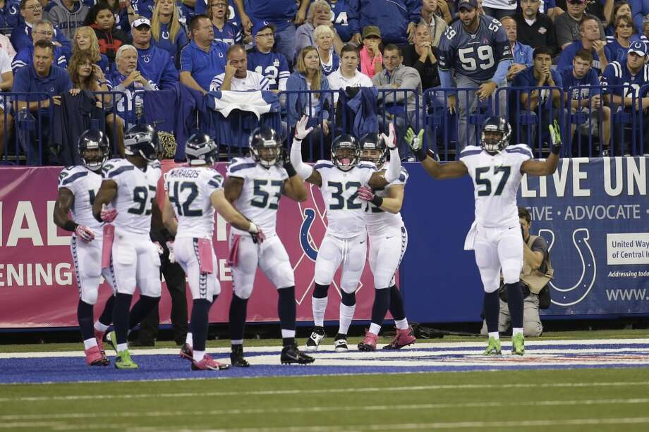 The Seattle Seahawks celebrates a safety on a blocked punt against the Indianapolis Colts during the first half of an NFL football game in Indianapolis, Sunday, Oct. 6, 2013. (AP Photo/AJ Mast) Photo: AJ Mast, AP