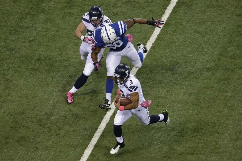 Seattle Seahawks quarterback Russell Wilson (3) is chased by Indianapolis Colts inside linebacker Jerrell Freeman during the first half of an NFL football game in Indianapolis, Sunday, Oct. 6, 2013. (AP Photo/AJ Mast) Photo: AJ Mast, AP